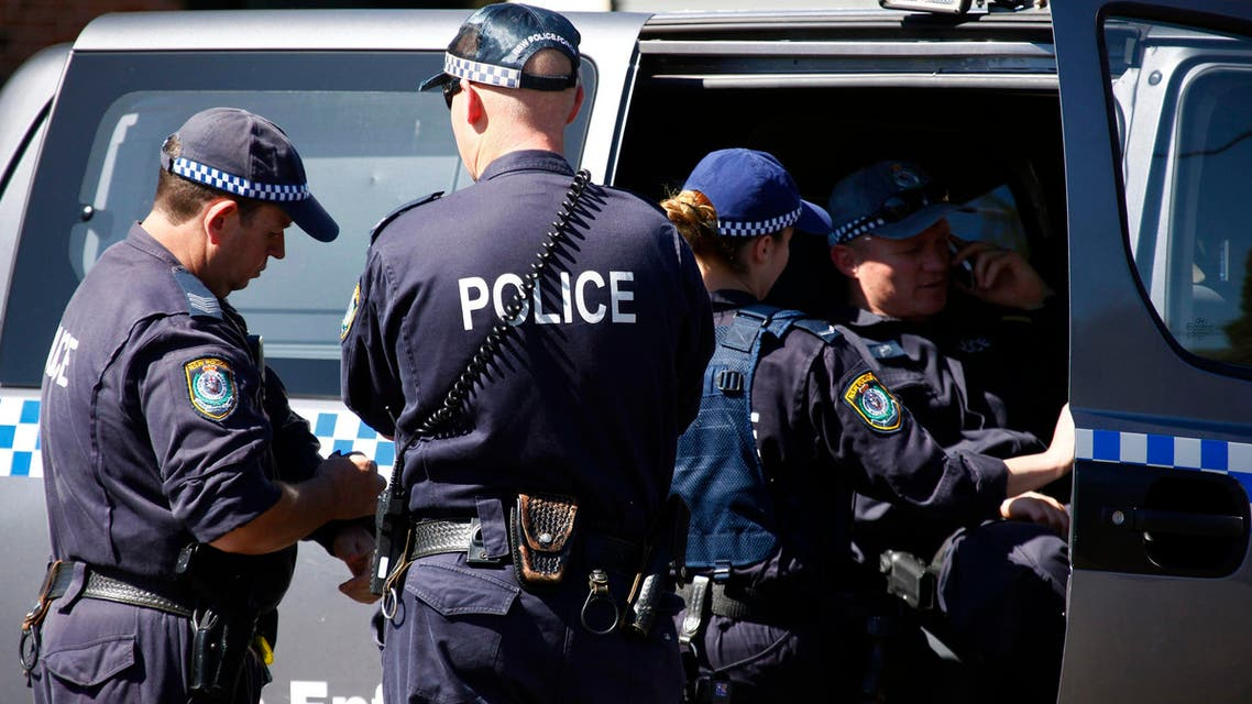 Police talk outside a house that was involved in pre-dawn raids in the western Sydney suburb of Guilford September 18, 2014. (Reuters)
