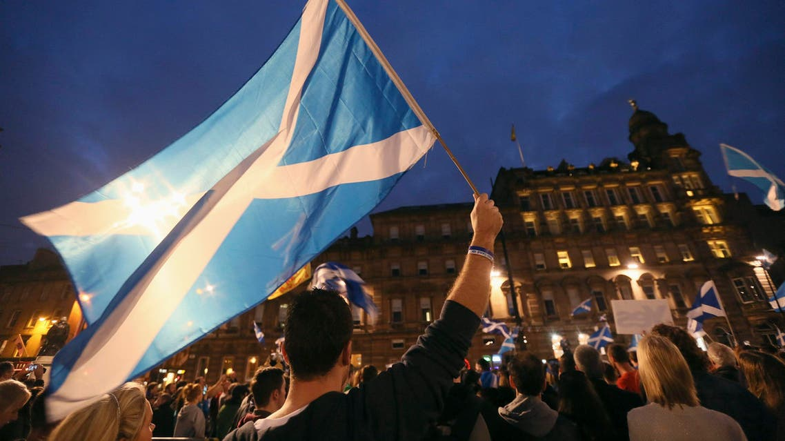 'Yes' campaigners holding Scottish Saltire flags gather for a rally in George Square, Glasgow, Scotland September 17, 2014. (Reuters)
