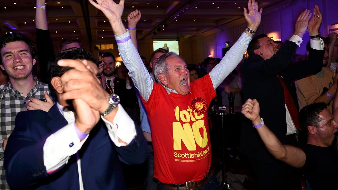 """Supporters from the """"No"""" Campaign react to a declaration in their favour, at the Better Together Campaign headquarters in Glasgow, Scotland September 19, 2014."""