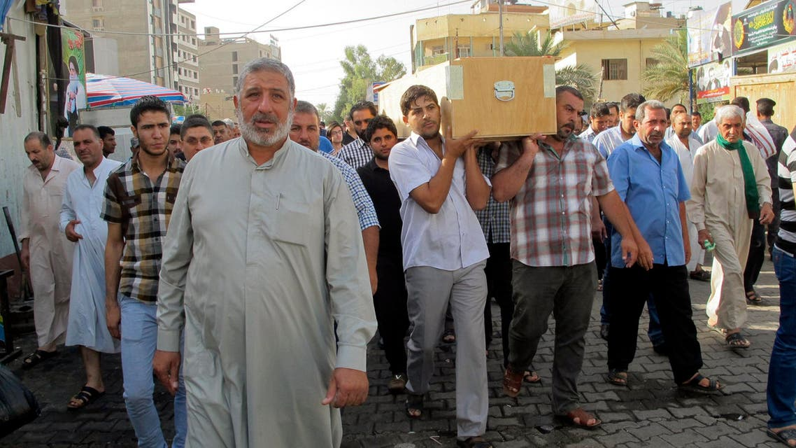 Mourners carry the coffin of their relative, who was killed in a car bomb attack in Baghdad's Kadhimiya district, September 19, 2014. (Reuters)