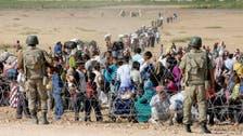 ألفا لاجئ يعبرون إلى تركيا بسبب المعارك في سوريا