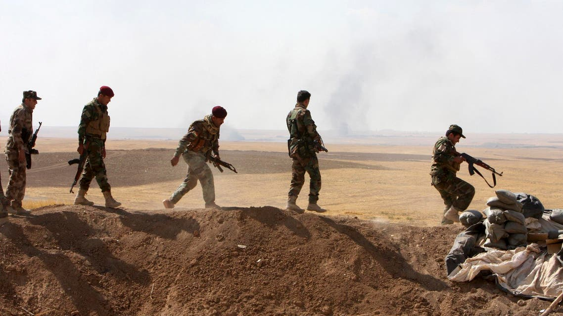 Kurdish peshmerga troops participate in an intensive security deployment against Islamic State militants on the front line in Khazir, September 16, 2014. (Reuters)