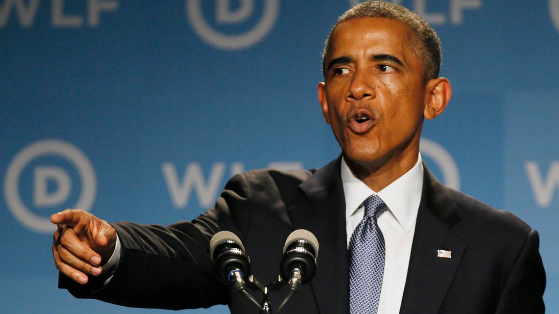 U.S. President Barack Obama gestures as he addresses the Democratic National Committee's Women�s Leadership Forum annual Issues Conference in Washington, September 19, 2014. Reuters