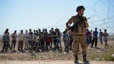 ISIS closes in on Syrian border town as Kurds flee