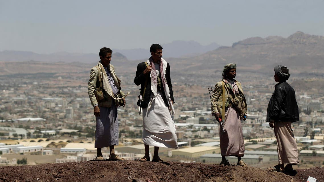 Shi'ite Houthi rebels stand on a hill at the army's First Armoured Division, after they took it over, in Sanaa September 22, 2014. (Reuters)