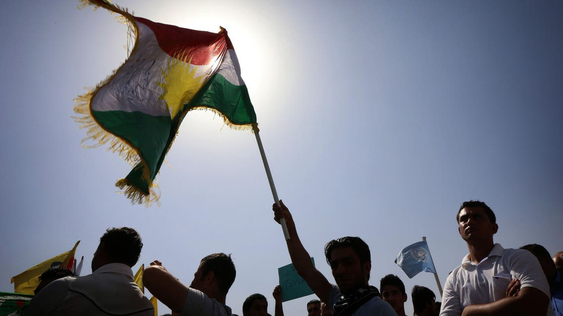 Iraqi Kurdish supporters of the Kurdistan Workers Party (PKK) demonstrate against the threat imposed by ISIS jihadists against Kurdish city of Kobani in northern Syria, outside the UN office in Erbil. (AFP)