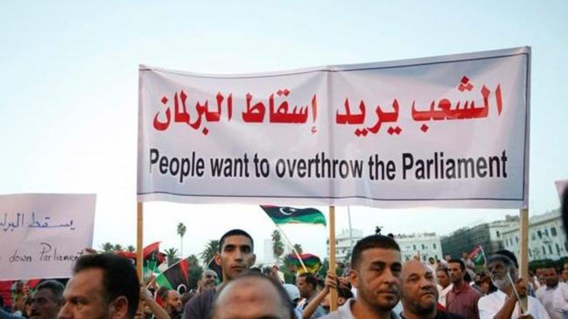 Supporters of Operation Dawn, a group of forces mainly from Misrata, demonstrate against the Libyan parliament at Martyrs' Square in Tripoli September 19, 2014. (Reuters)