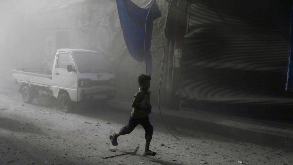 Residents carry an injured man after what activists said were two air strikes by forces of Syria's President Bashar al-Assad. (Reuters)