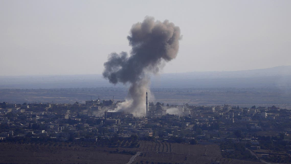 Smoke rises from the Syrian Syrian village of Jubata al-Khashab after it was bombed by a Syrian fighter jet on September 23, 2014, moments before the jet was shot down by the Israeli military over the Golan Heights.