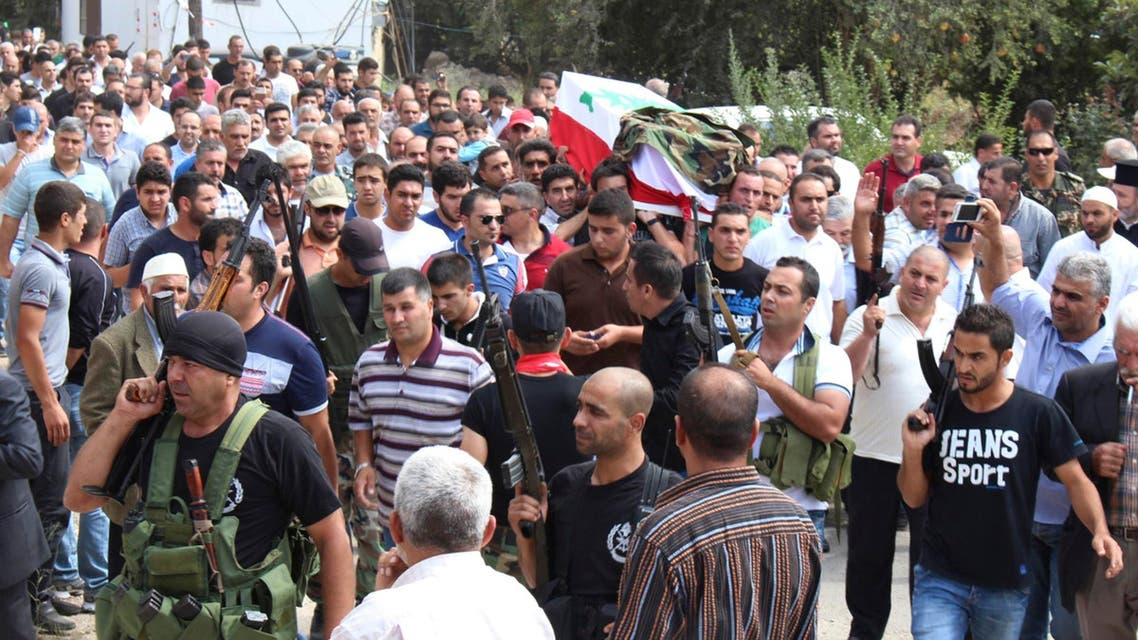 Lebanese army soldiers and relatives of soldier Mohamed Assem Dahir, who was killed by a roadside bomb near the border town of Arsal, carry his coffin during his funeral in Aidmon town, Akkar September 20, 2014. (Reuters)