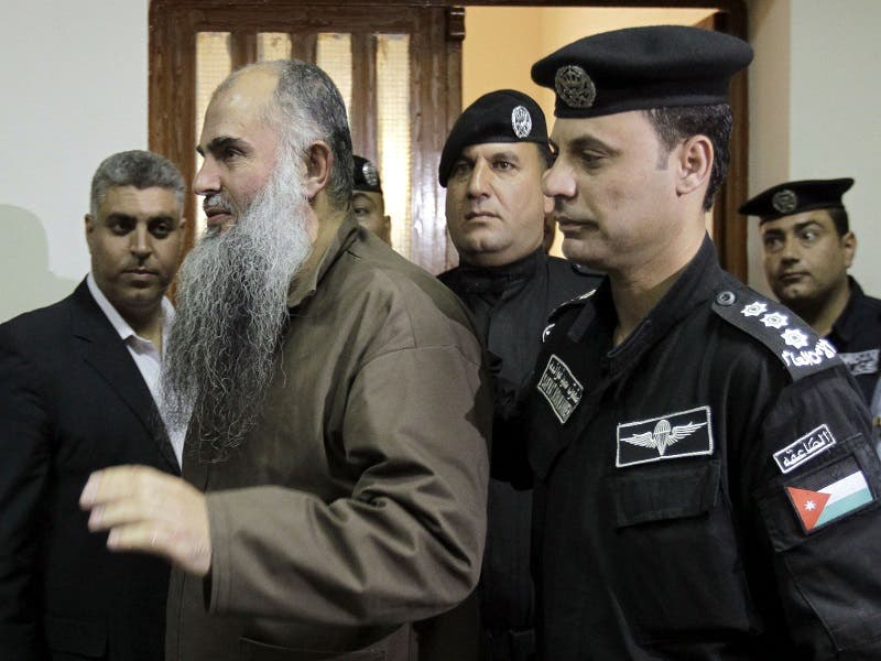 Radical Islamist cleric Abu Qatada (2L), born Omar Mahmud Mohammed Otman, is escorted to the Jordanian State Security court, in Amman on September 24, 2014. (AFP)