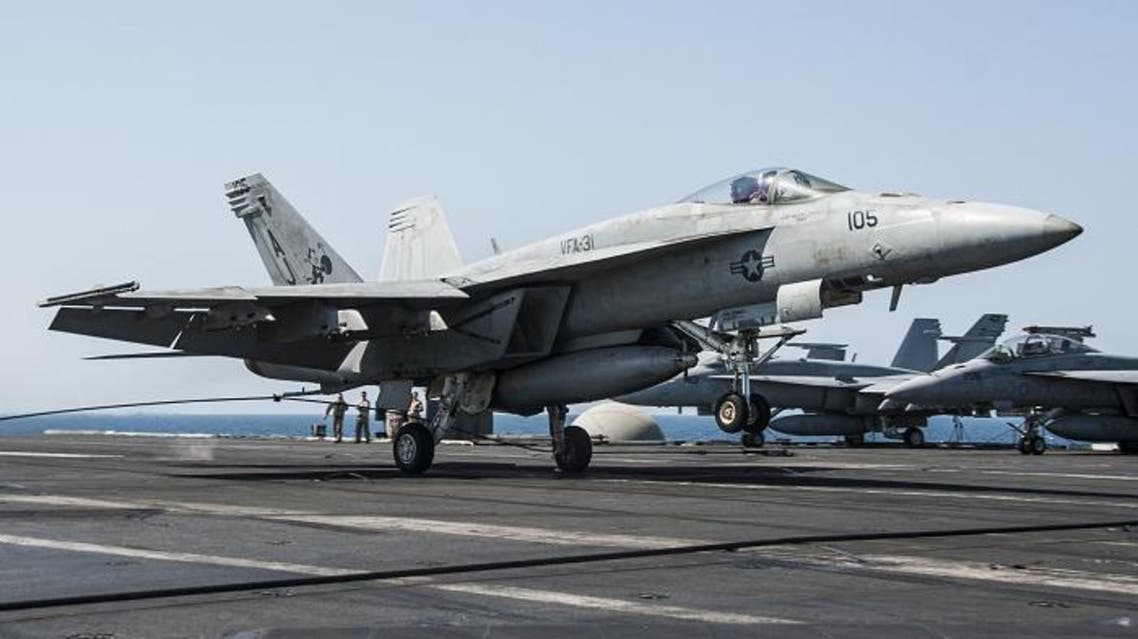 In this picture downloaded from the US Navy website and taken on September 23, 2013, an F/A-18E Super Hornet attached to the Tomcatters of Strike Fighter Squadron (VFA) 31 lands aboard the aircraft carrier USS George H.W. Bush (CVN 77)after conducting strike missions against Islamic State (IS) group targets. (AFP)