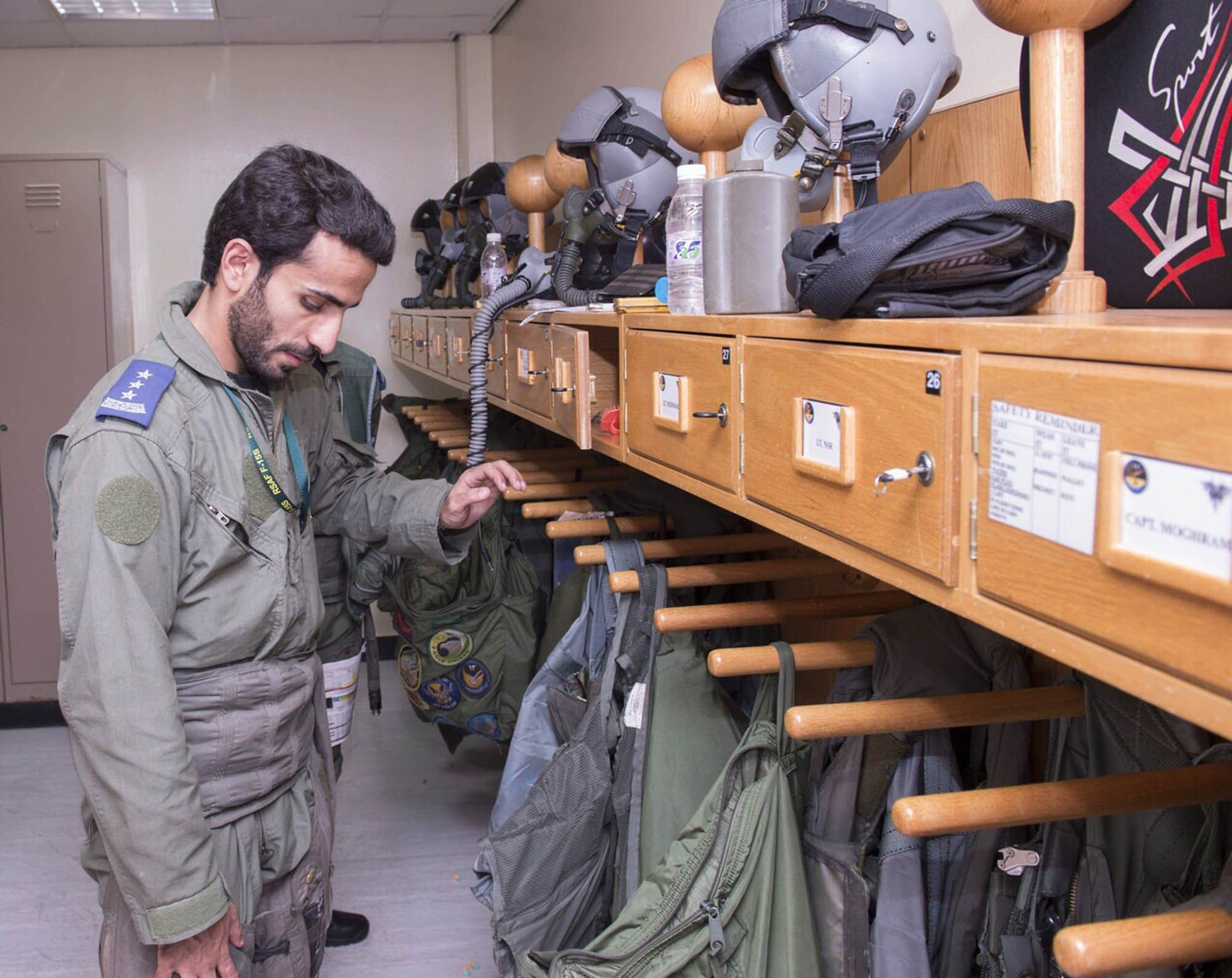 In a handout picture released by the official Saudi Press Agency (SPA), a Saudi Arabian air force pilot looks at flying jackets at an undisclosed location on September 23, 2014. AFP