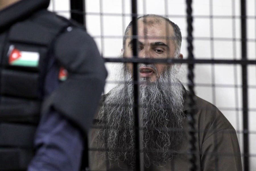 Radical Islamist cleric Abu Qatada, born Omar Mahmud Mohammed Otman, sits behind bars in the Jordanian State Security court in Amman on September 24, 2014. (AFP)