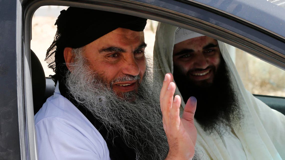 Radical Muslim cleric Abu Qatada (L) waves next to his son after his release from a prison near Amman Sept. 24, 2014. (Reuters)