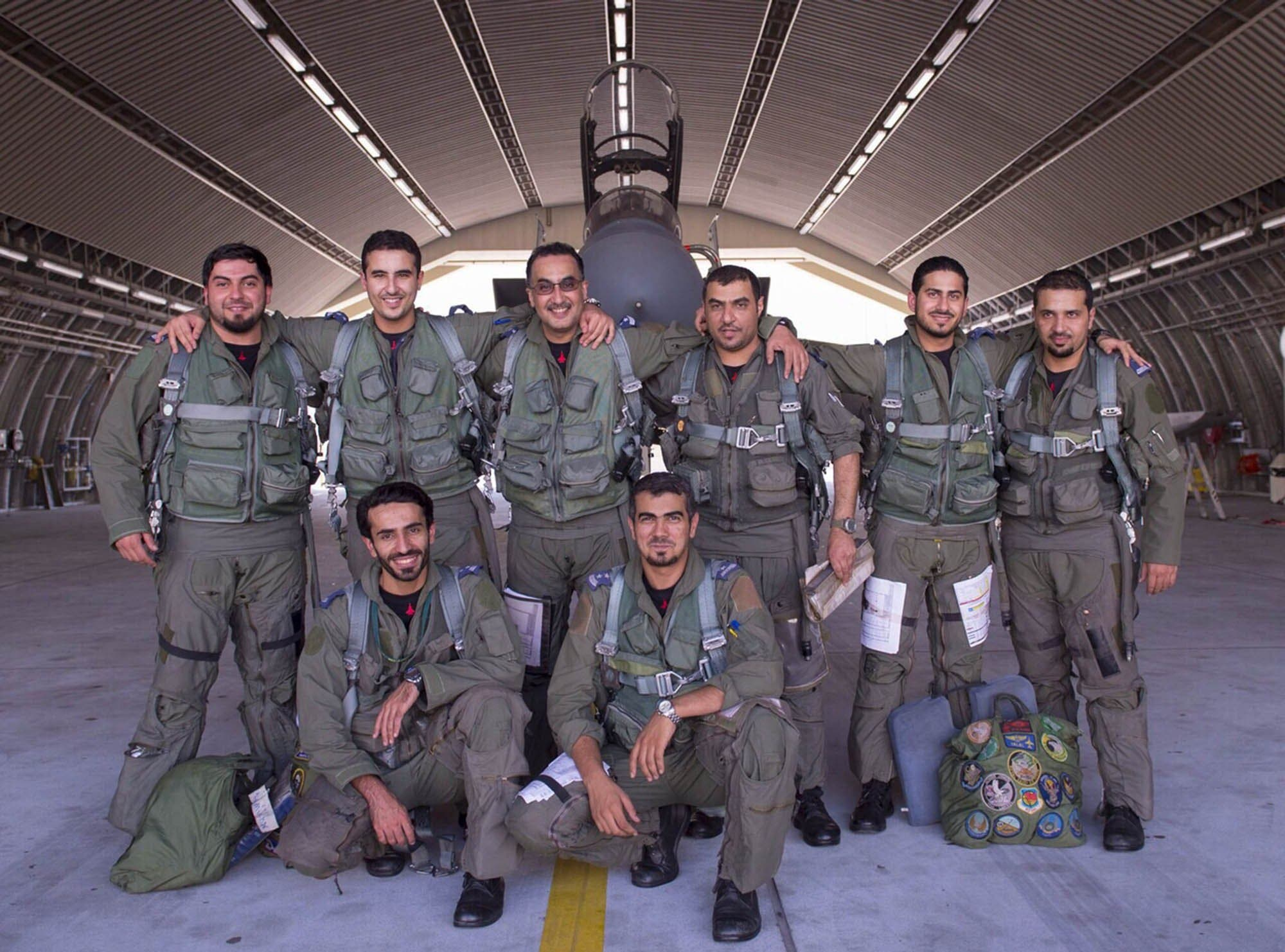 In a handout picture released by the official Saudi Press Agency (SPA), Saudi Arabian air force pilots pose for a photo at an undisclosed location after taking part in a mission to strike Islamic State (IS) group targets in Syria on September 23, 2014. AFP