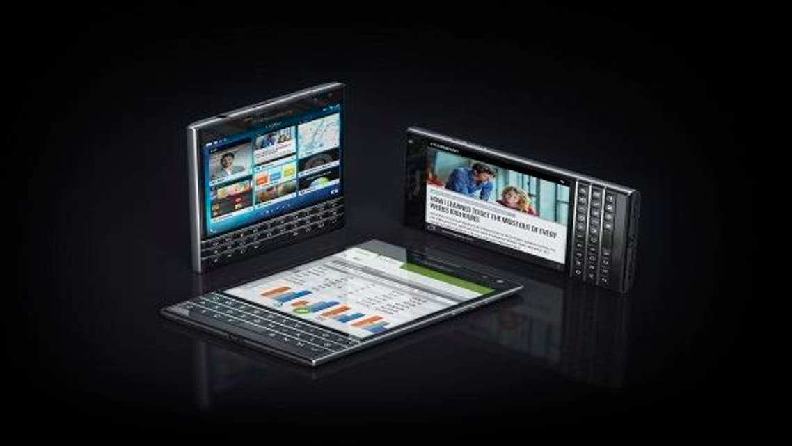 The new BlackBerry 'Passport'  is the size and shape of a closed passport, with a large square touchscreen as well as a  Keyboard. (Al Arabiya)