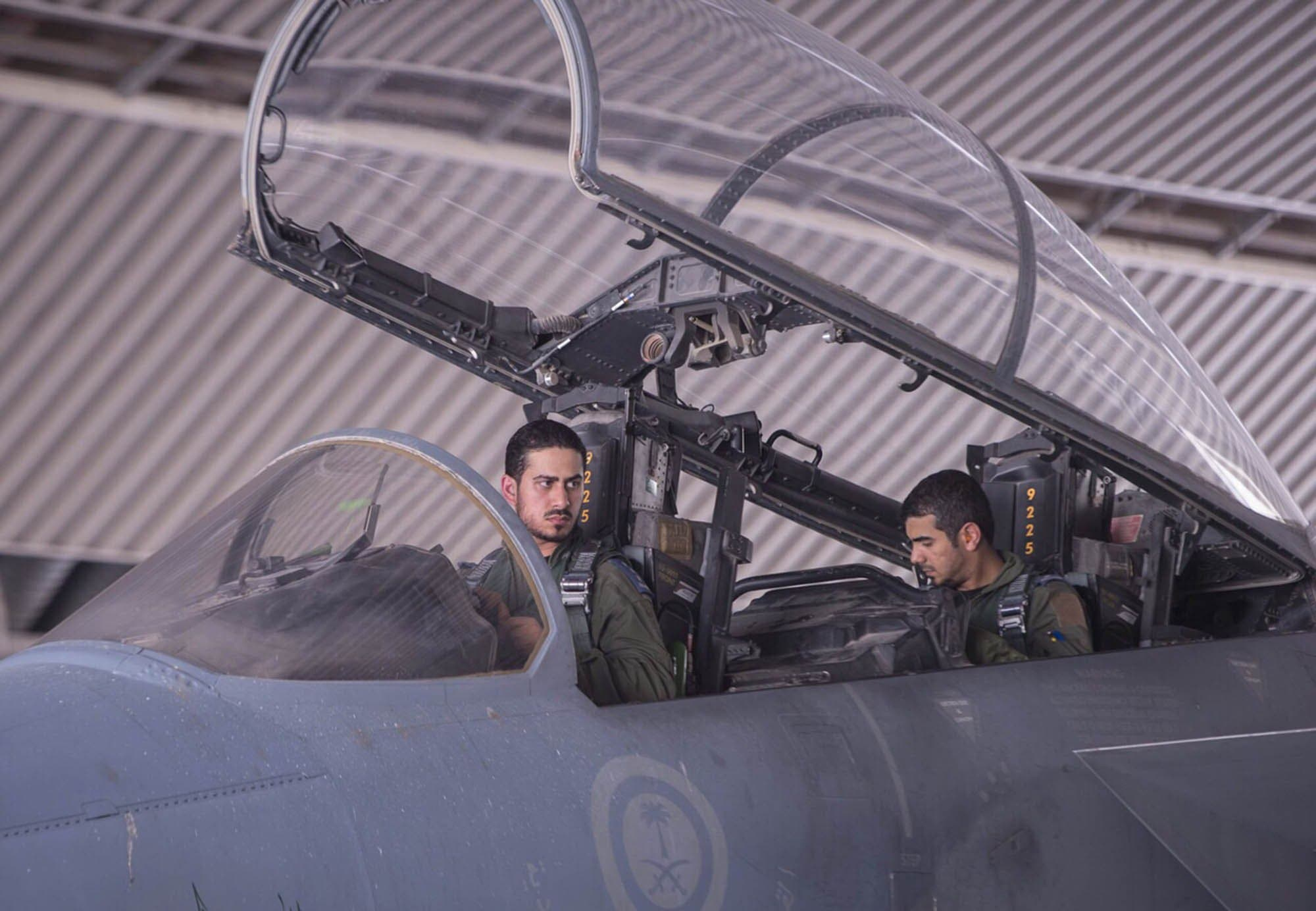 In a handout picture released by the official Saudi Press Agency (SPA), Saudi Arabian air force pilots sit in the cockpit of a fighter jet at an undisclosed location on September 23, 2014 AFP
