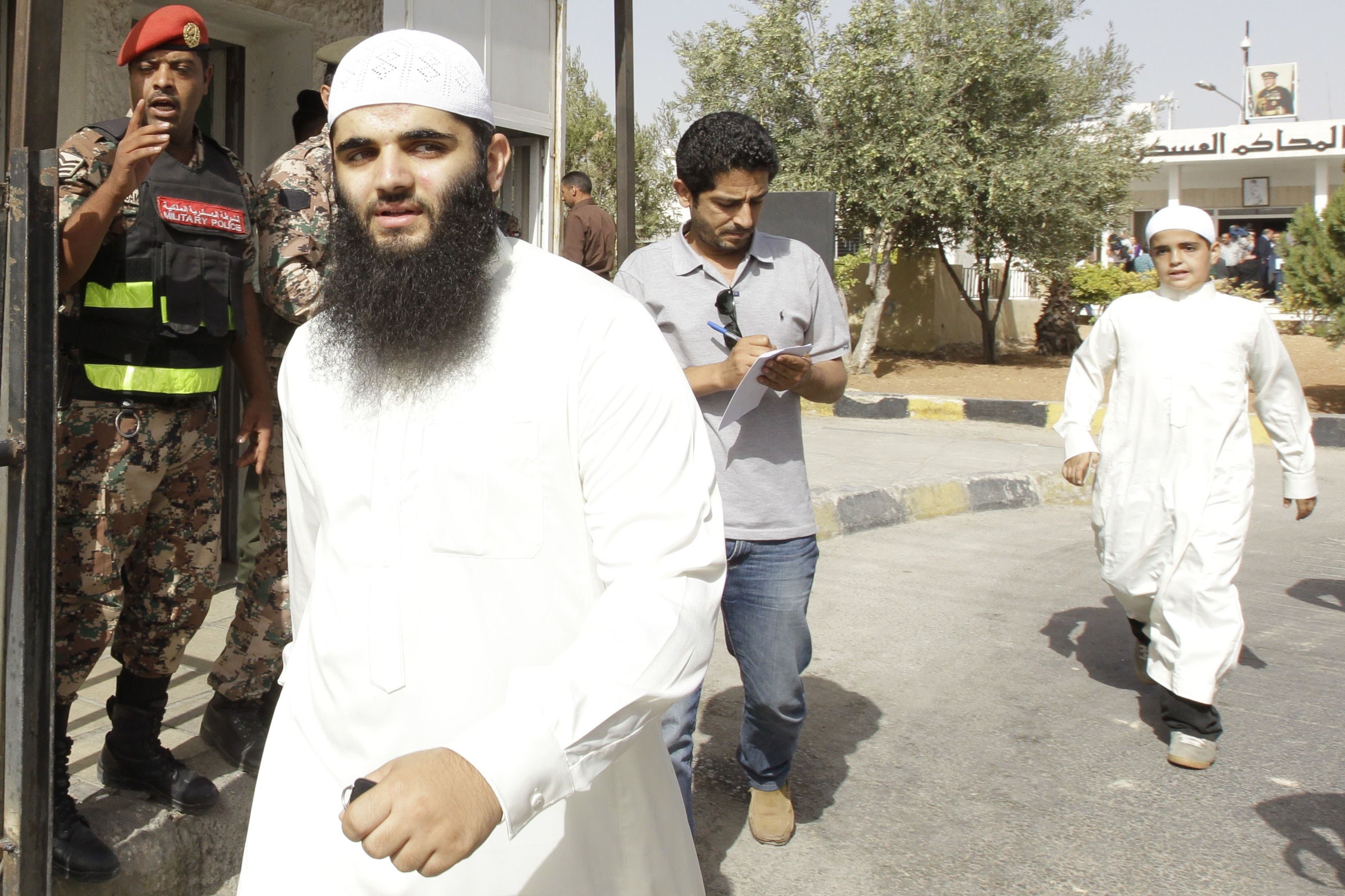Relatives of radical Islamist cleric Abu Qatada, are pictured outside the Jordanian State Security court in Amman. (AFP)
