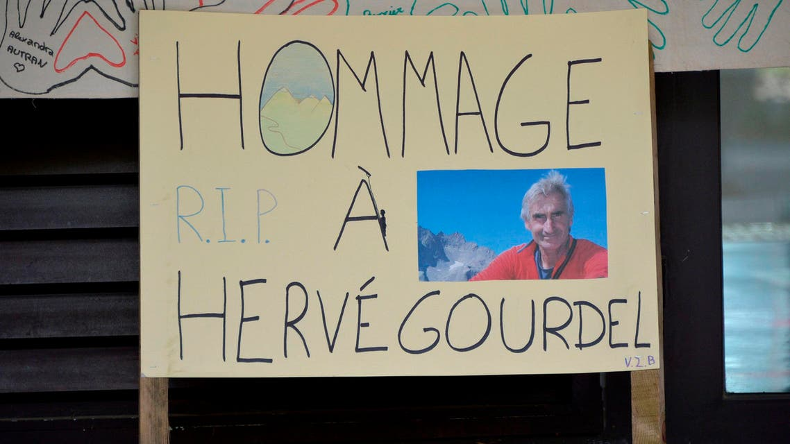 A placard with a portrait of mountain guide Frenchman Herve Gourdel which reads Tribute to Herve Gourdel is displayed in front of the Lycee de la Montagne High School in Valdeblore near Saint-Martin-Vesubie, September 25, 2014. (Reuters)