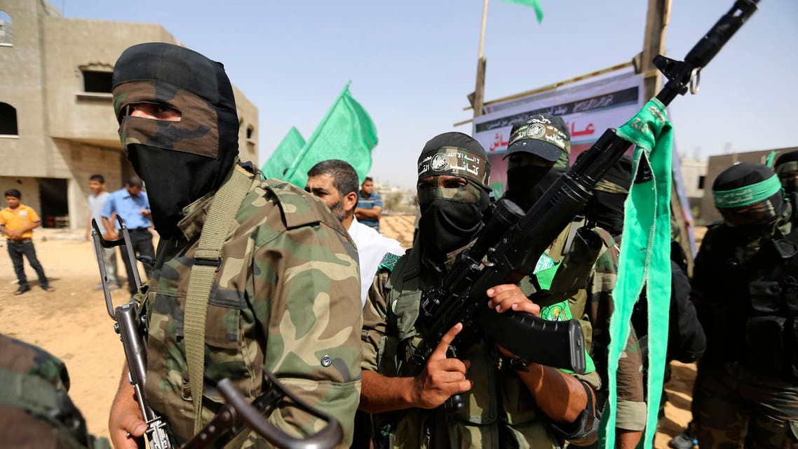 Palestinian Hamas militants stand guard as others celebrate the release of Palestinian Suliman al-Hasash from an Israeli jail, in Rafah in the southern Gaza Strip September 24 , 2014.