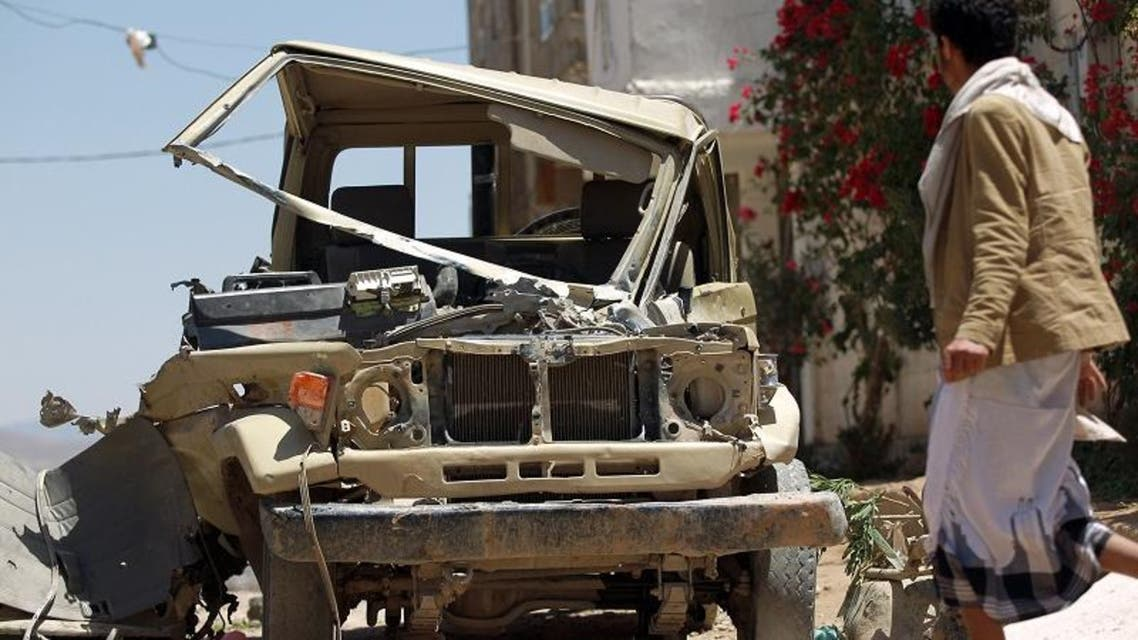"Yemeni walks past an army's vehicle which was damaged during recent fighting between government army troops and Shiite Huthi rebels, in the capital Sanaa on September 23, 2014. Yemeni President Abdrabuh Mansur Hadi vowed to restore state authority and warned of ""civil war"" in the Sunni-majority country as Shiite rebels were seen in near-total control of the capital. AFP"
