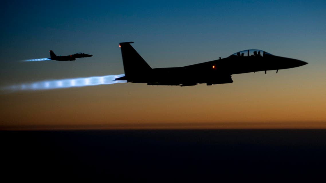 A pair of U.S. Air Force F-15E Strike Eagles fly over northern Iraq after conducting airstrikes in Syria, in this U.S. Air Force handout photo taken early in the morning of September 23, 2014. (Reuters)