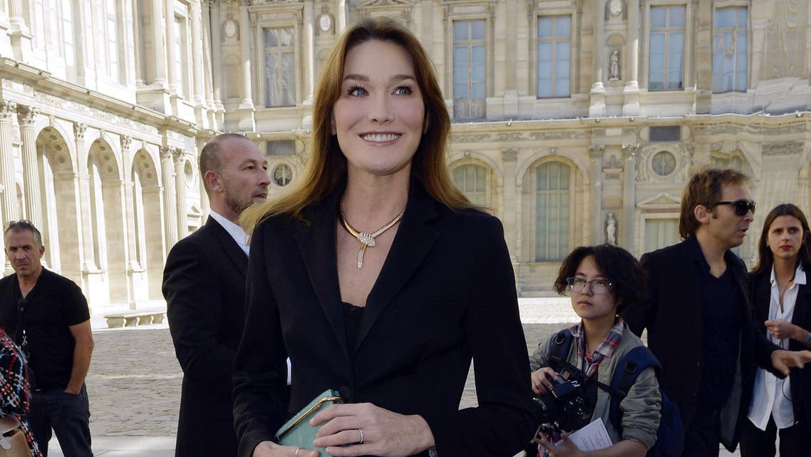 French singer and former First Lady Carla Bruni-Sarkozy poses upon arrival prior to the start of the Christian Dior 2015 Spring/Summer ready-to-wear collection fashion show, on September 26, 2014 in Paris.  (AFP)