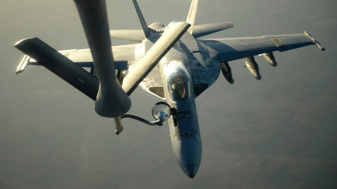 A U.S. Navy F-18E Super Hornet receives fuel from a KC-135 Stratotanker over northern Iraq after conducting air strikes in Syria on September 23, 2014.  R