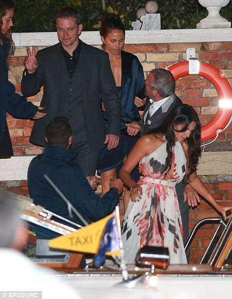 Matt Damon and wife Luciana Barroso step into the taxi boat that took them to the rehearsal dinner. (Photo courtesy: Xposure)