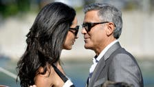 Clooney at Comic Con, wife gets back to work in Greece
