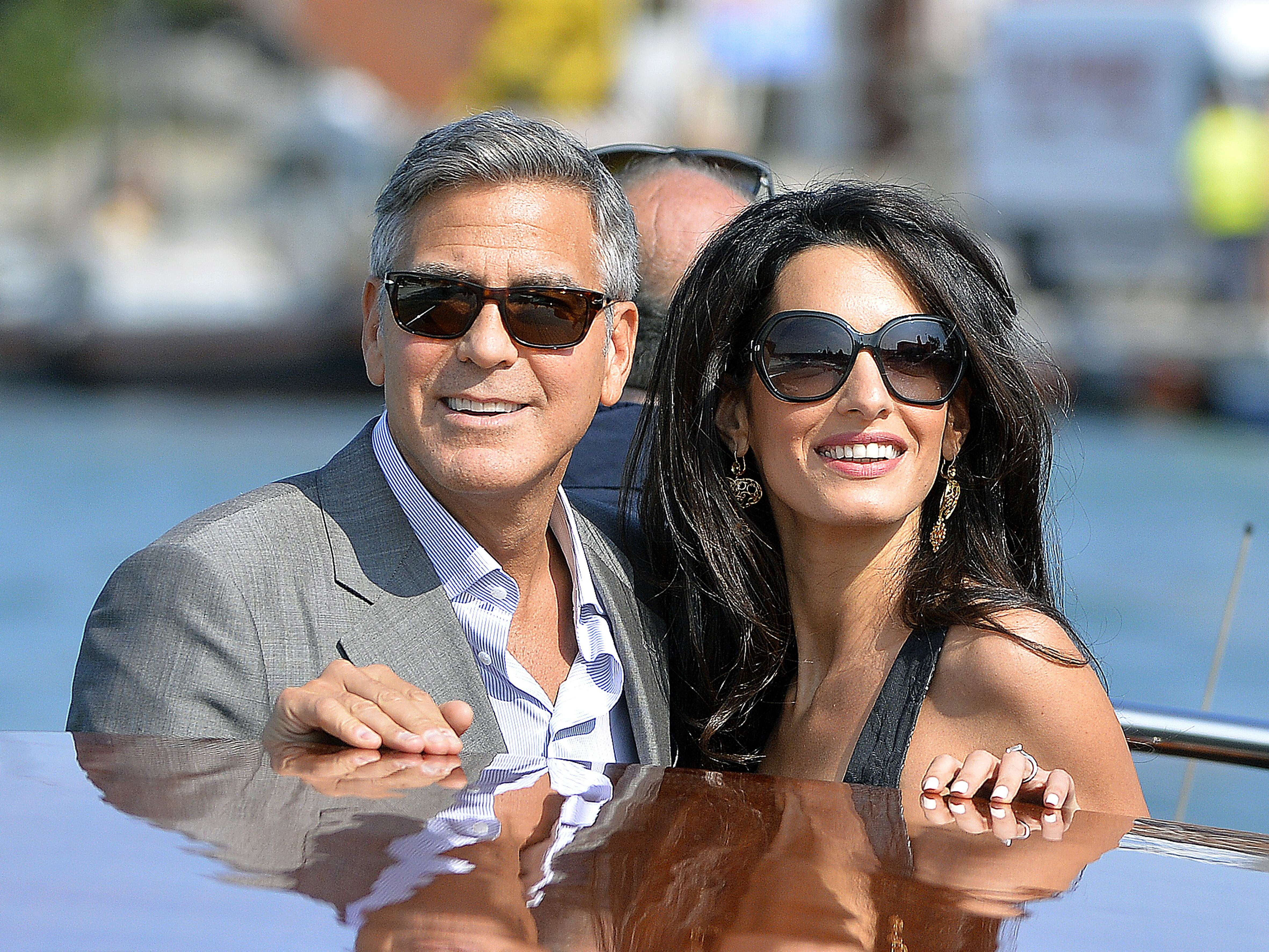 US actor George Clooney ( L) and his Lebanon-born British fiancee Amal Alamuddin take a taxiboat upon their arrival in Venice on September 26, 2014. (AFP)