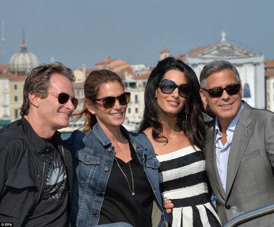 Cindy Crawford and husband – and best man- Rande Gerber pose with the bride and groom. (Photo courtesy: EPA)