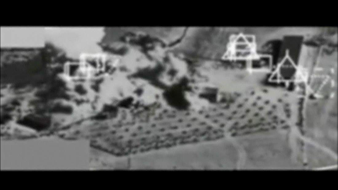 Still image taken from black and white video from a plane camera shows smoke rising after a strike near Kobani September 27, 2014. (Reuters)