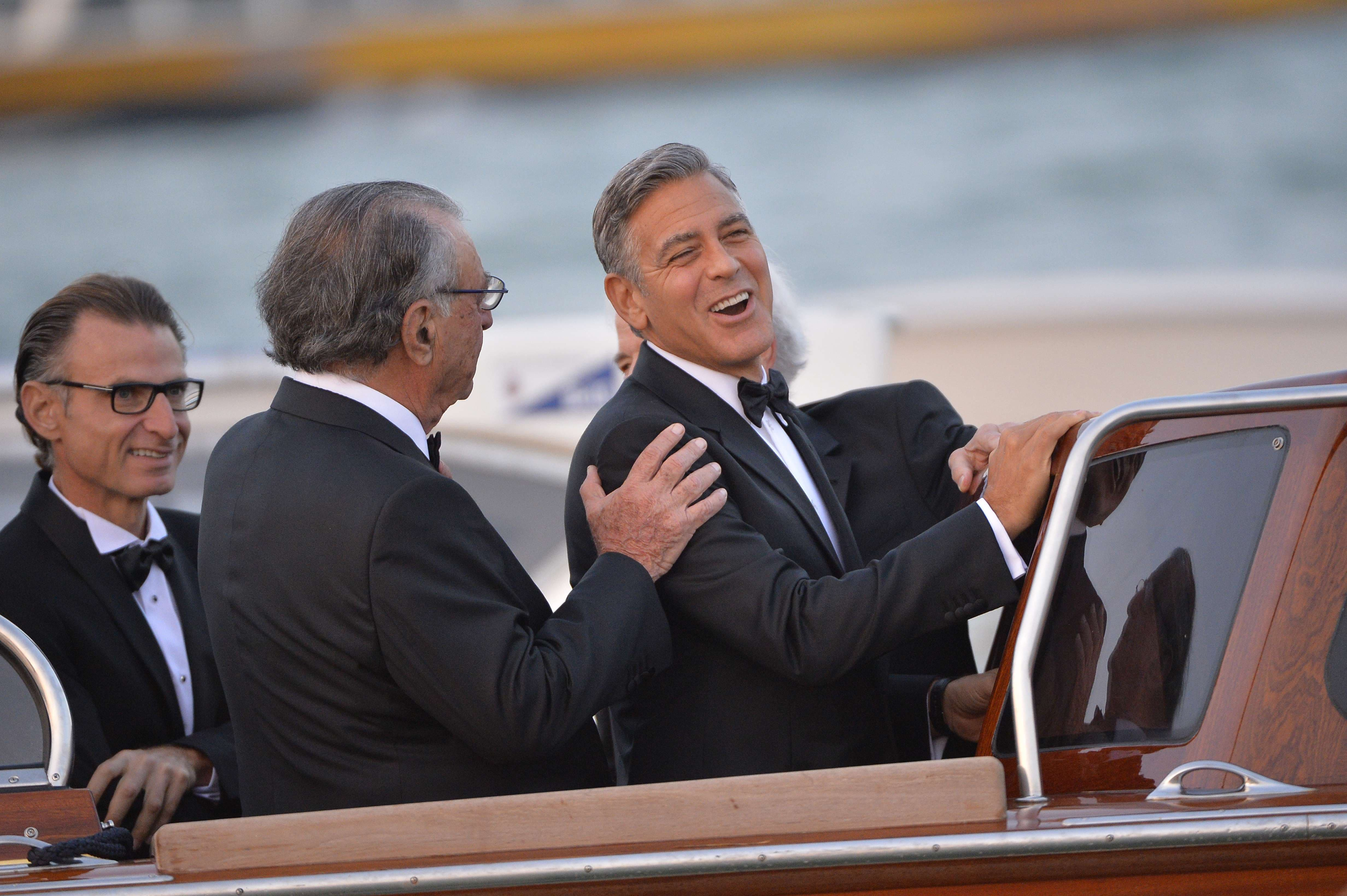 US actor George Clooney (R) is pictured on a taxi boat after he leaves the Cipriani hotel on September 27, 2014. (AFP)