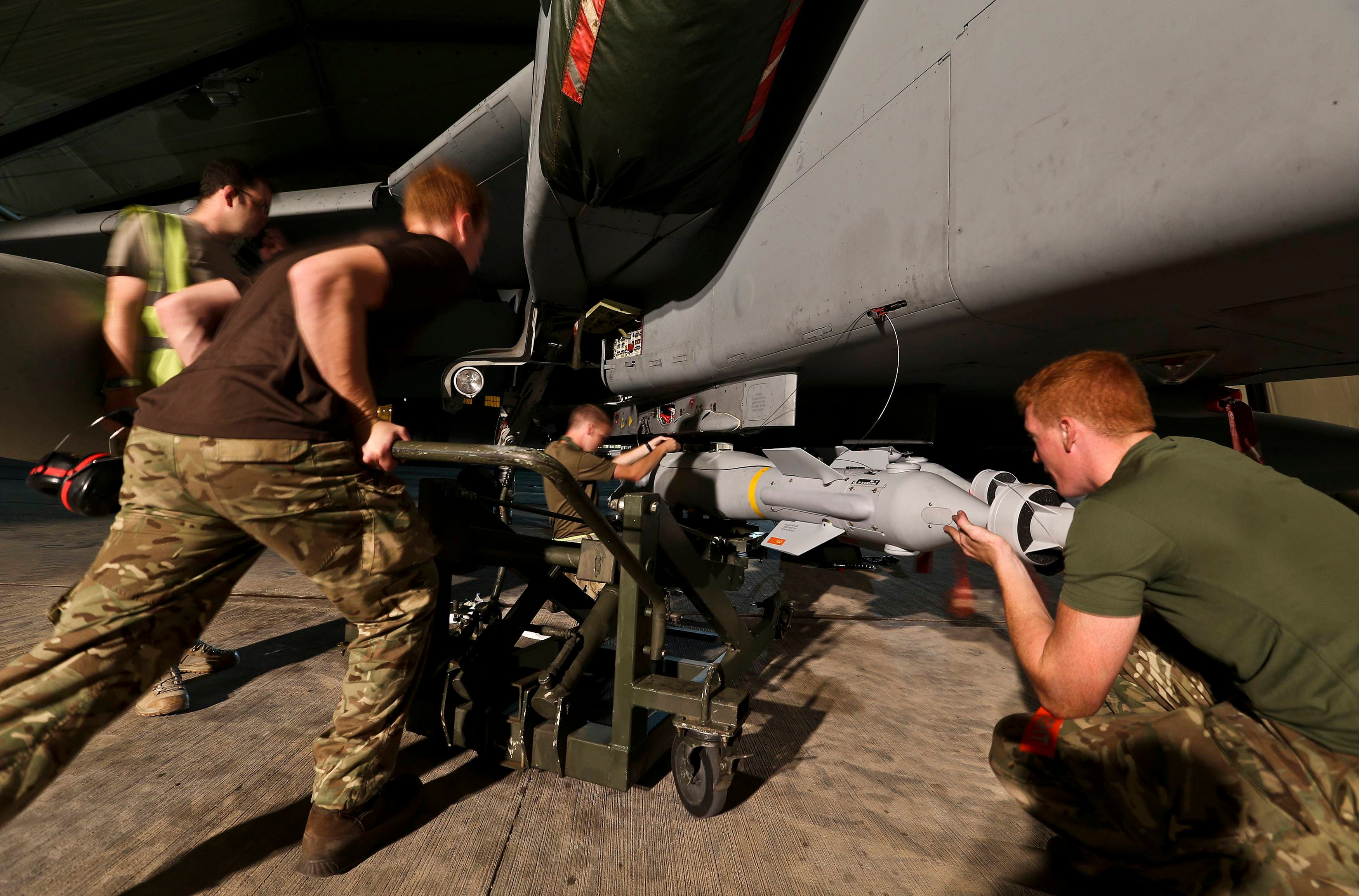 Ground crew load a Paveway IV Laser Guided bomb onto an RAF Tornado GR4's at RAF Akrotiri, Cyprus, in this handout photo from the Ministry of Defence September 26, 2014. (Reuters)