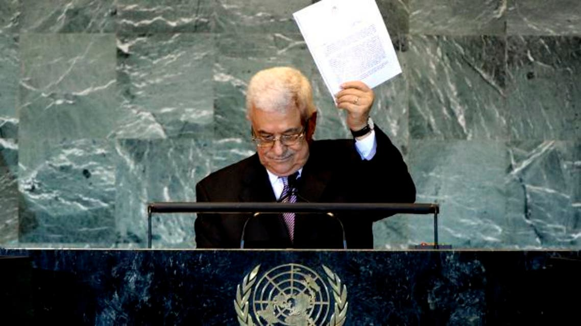 Palestinian President Mahmoud Abbas holds up a copy of the letter that he had just delivered to United Nations Secretary General Ban Ki-moon requesting full United Nations representation for a Palestinian state, during his address before the 66th United Nations General Assembly at U.N. headquarters in New York, September 23, 2011.