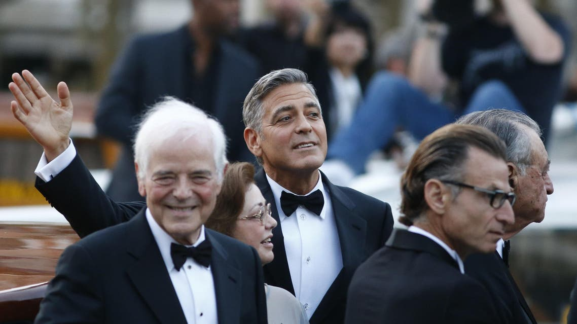 US actor George Clooney (C) arrives with his father Nick Clooney (L) at the Aman hotel on September 27, 2014. (AFP)