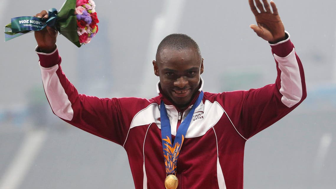 Qatar's Femi Seun Ogunode poses with his gold medal on the podium at the award ceremony for the men's 100m final at the Incheon Asiad Main Stadium during the 17th Asian Games Sept. 28, 2014. (Reuters)