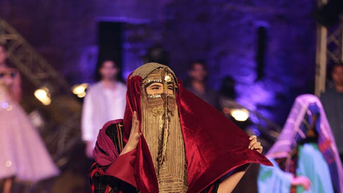 Lara Debbane displays her Bedouin dress on stage during the Miss Egypt competition pre-final at the Saladin Citadel in Cairo, Egypt, Saturday, Sept. 20, 2014. The final will be held at the Egypt's popular resort Sharm el-Sheikh on Friday, Sept. 26. (AP Photo/Hassan Ammar)