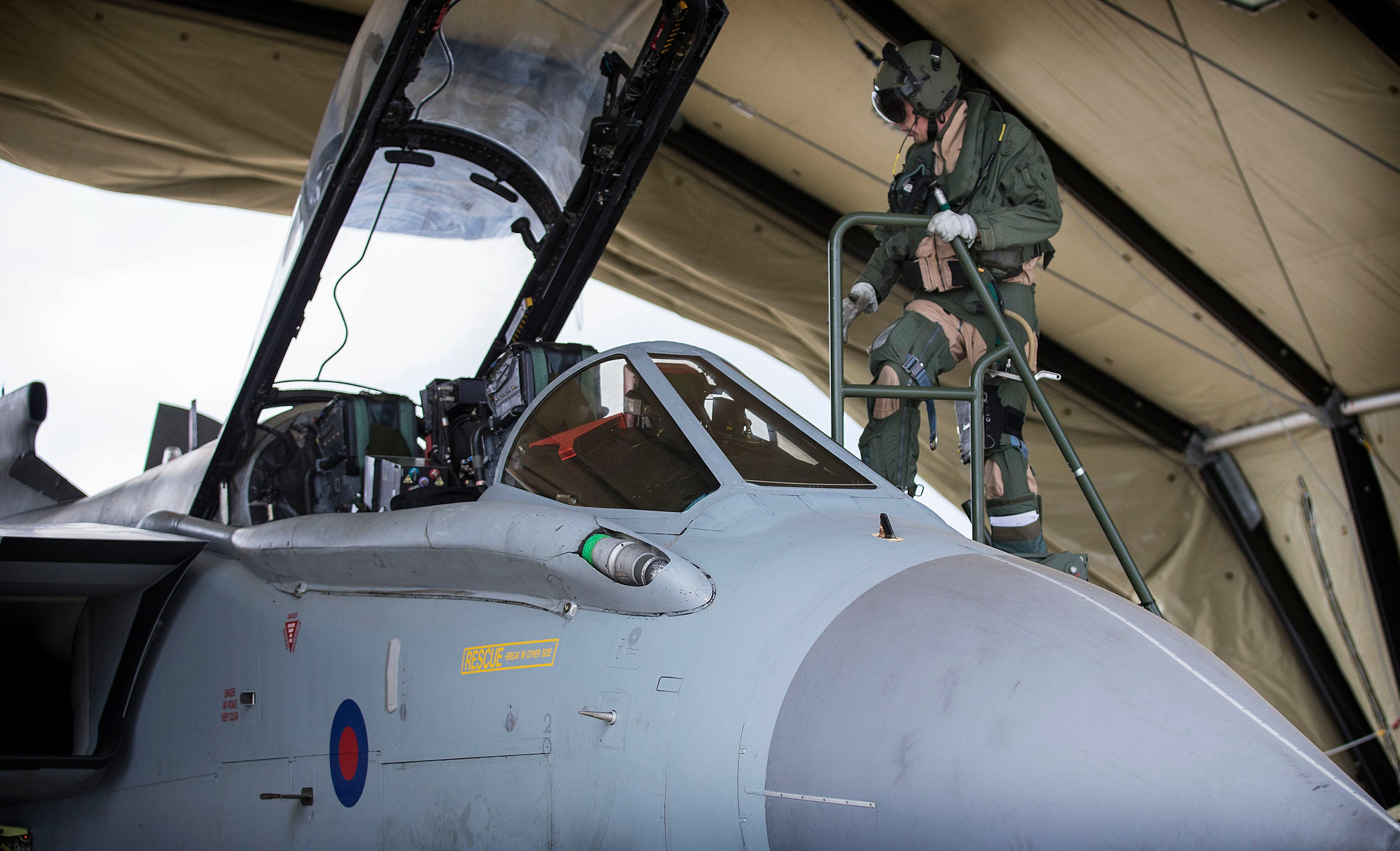 The flight crew of an RAF Tornado GR4 prepare to begin a combat mission at Akrotiri, Cyprus, in this handout image from the Ministry of Defence September 27, 2014. (Reuters)