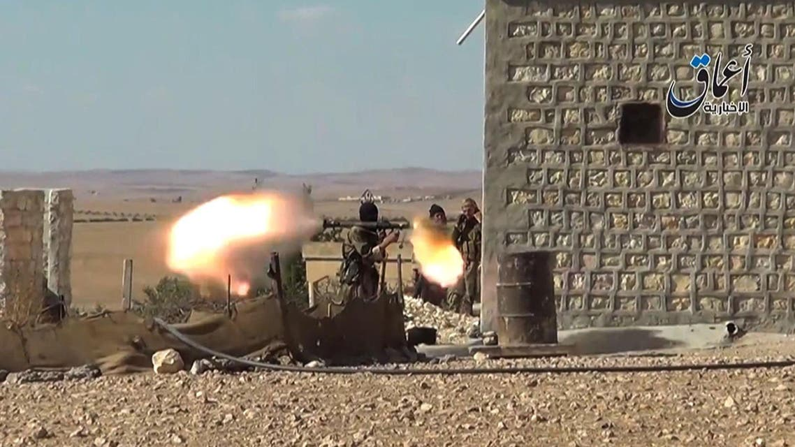 An ISIS militant firing a rocket propelled grenade (RPG) launcher during fighting near the Syrian Kurdish town of Ain al-Arab, known as Kobane by the Kurds.(AFP)