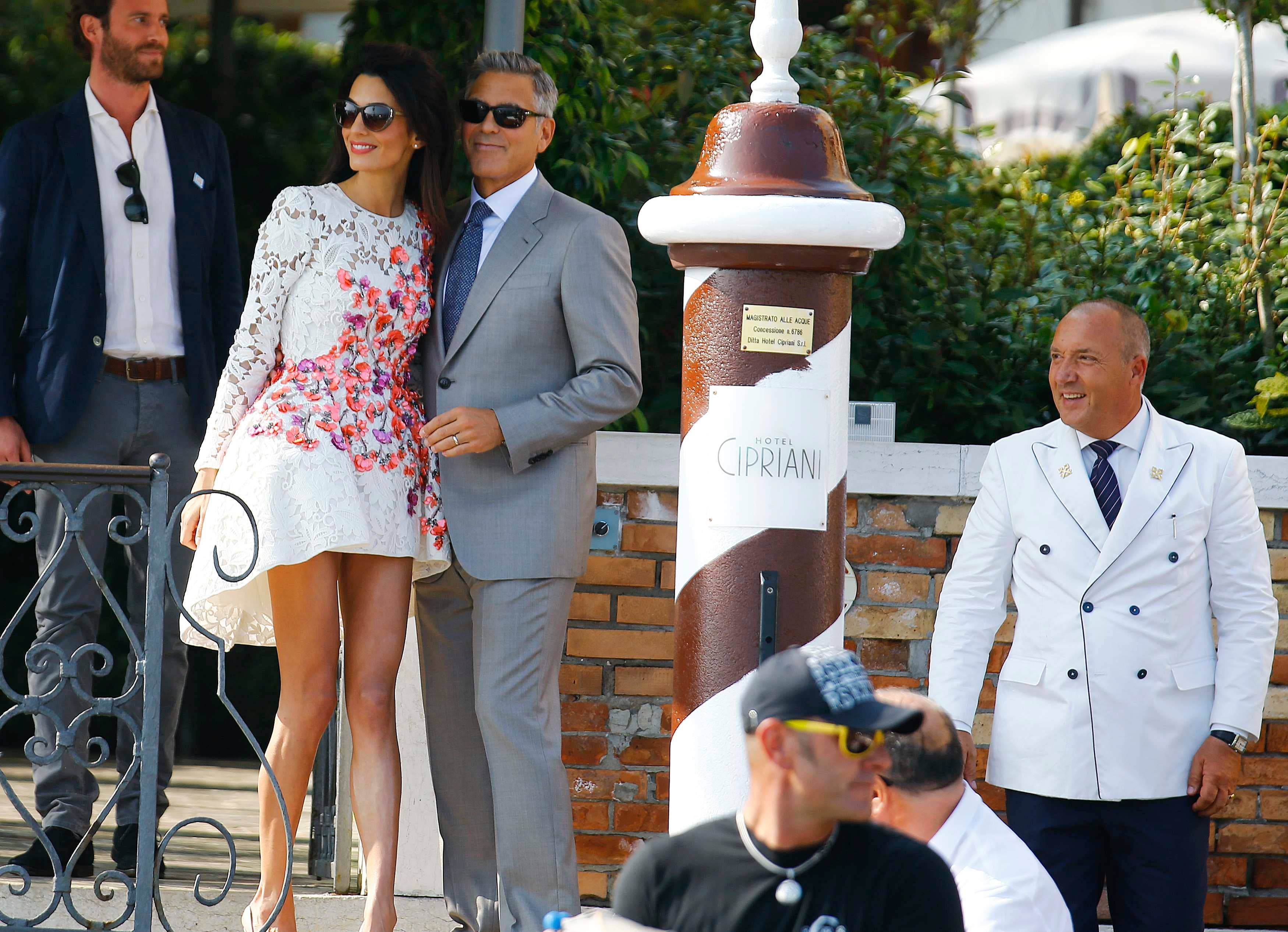 U.S. actor George Clooney (3rd L) and his wife Amal Alamuddin arrive at the Cipriani hotel in Venice September 28, 2014. (Reuters)