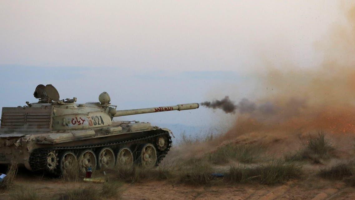 Fighters of Libya's Fajr Libya (Libyan Dawn) militia fire a cannon against a rival militia some 27 kilometers West of the Libyan capital Tripoli, on Sept. 29, 2014. (AFP)