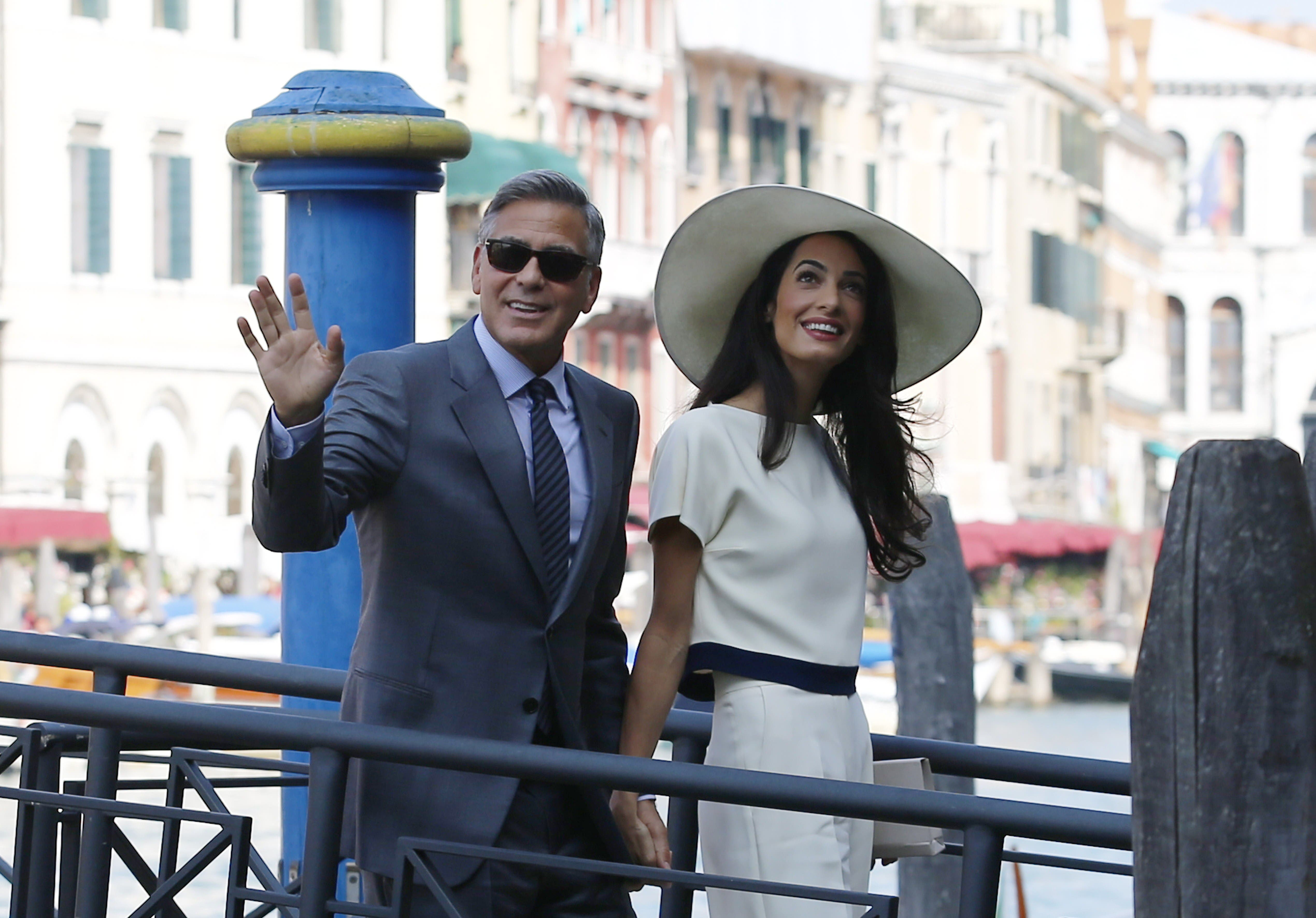 US actor George Clooney and British lawyer Amal Alamuddin arrive on September 29, 2014 at the palazzo Ca Farsetti in Venice, for a civil ceremony to officialise their wedding. AFP
