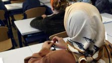 Hijab debate returns to France after student asked to remove her 'thing'