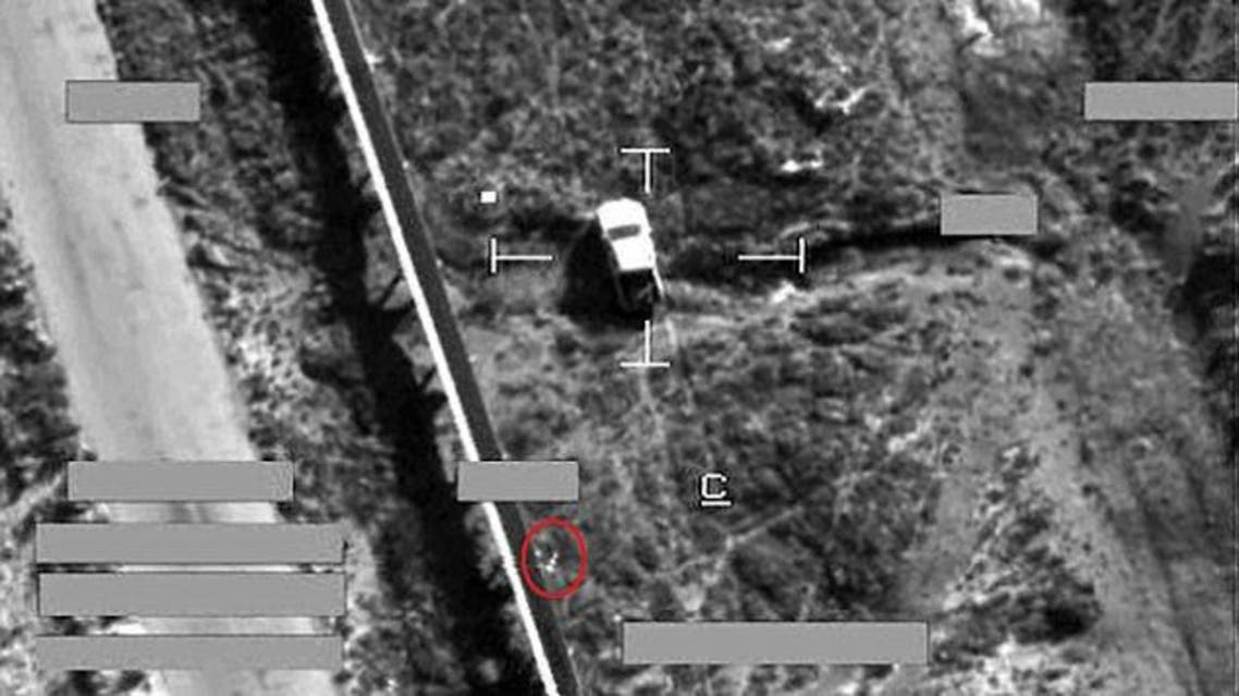 Target: This is the moment a brimstone missile from an RAF jet (circled) fell on an armed pick-up truck in Iraq during an airstrike against Islamic State fighters today