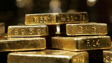 Gold down on dollar after worst month in two years