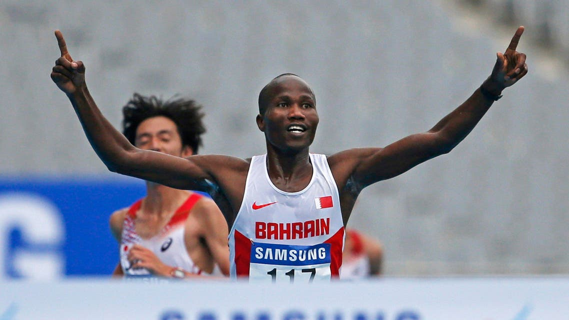 Bahrain's Ali Hasan Mahboob reacts as he prepares to cross the finish line to win the men's marathon at the Incheon Asiad Main Stadium during the 17th Asian Games October 3, 2014. (Reuters)