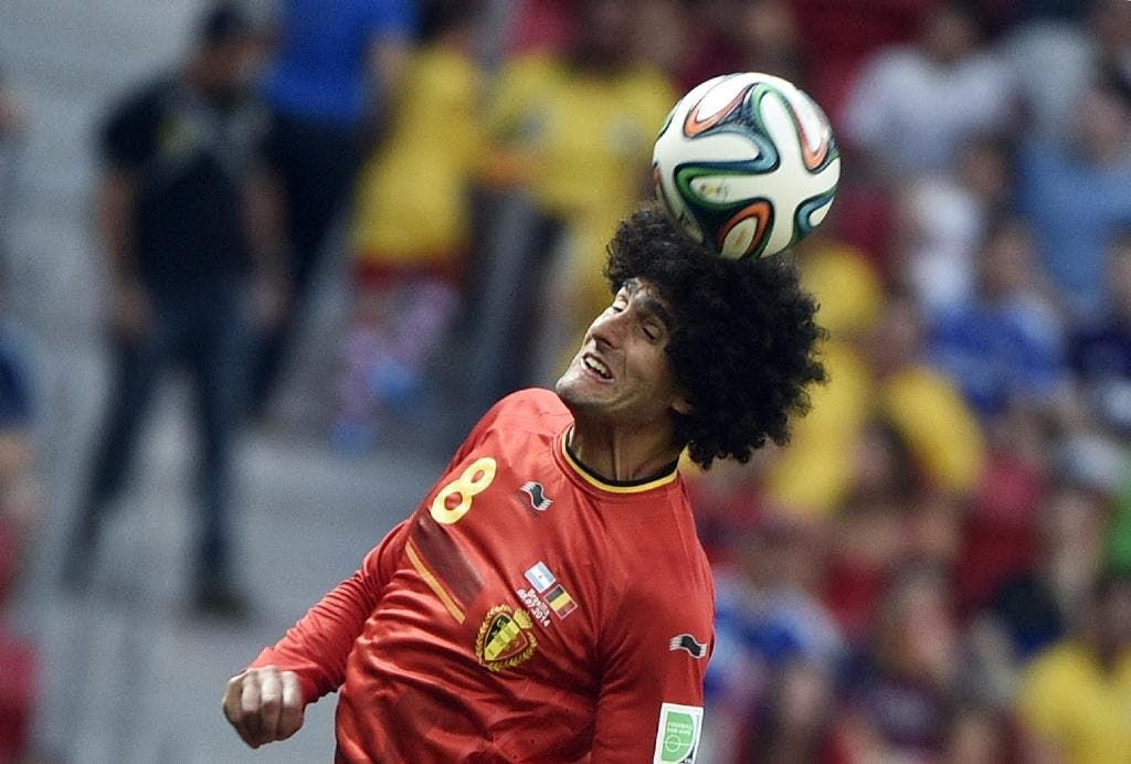 Belgium's midfielder Marouane Fellaini heads the ball during a quarter-final football match between Argentina and Belgium. (AFP)